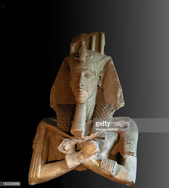 Bust from a colossal statue of Akhenaten one of a series depicting the king in various guises erected at the new solar temple of Aten constructed by...