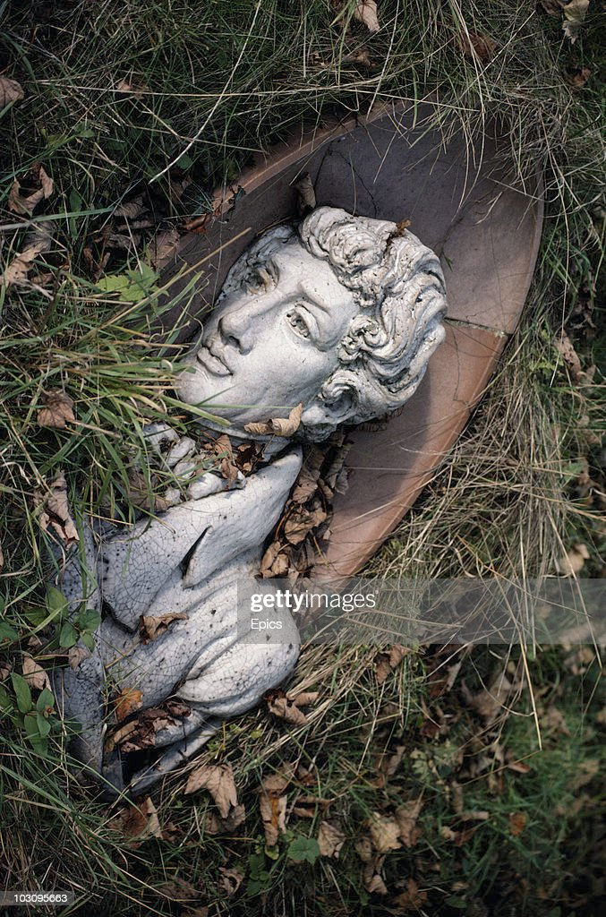 A bust of British author and essayist Charles Lamb (1775-1834) lies in the overgrown garden to the side of Button Snap Cottage, in the village of Westmill, Buntingford, Hertfordshire October 1979. Charles Lamb owned the cottage from 1812-185.