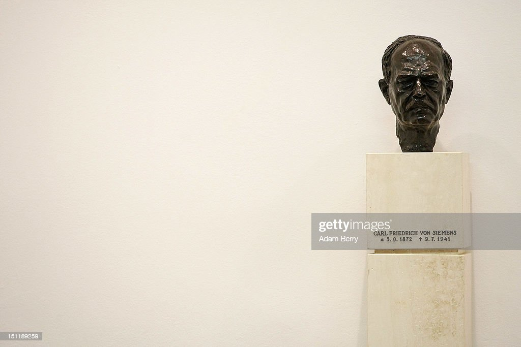 A bust of Carl Friedrich von Siemens, responsible for the resurrection of the Siemens Group after the First World War, sits on display at a Siemens training center on September 3, 2012 in Berlin, Germany. Nearly 400 trainees began their apprenticeship training programs today at an in-house educational facility at the Siemens factory in Berlin.