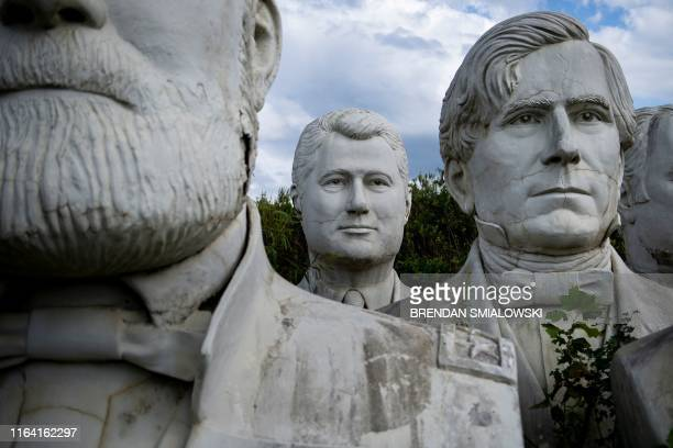 A bust of former US President Bill Clinton can be seen among other busts of former US Presidents at a mulching business where they now reside August...
