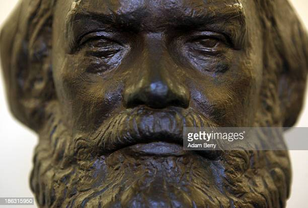 A bust of German philosopher and economic theorist Karl Heinrich Marx remembered as the founder of modern Socialism and Communism sits on display at...