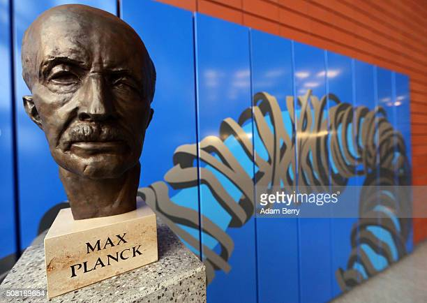 A bust of Max Planck German theoretical physicist specialized in quantum theory is seen on February 3 2016 sits in front of an image of the new...