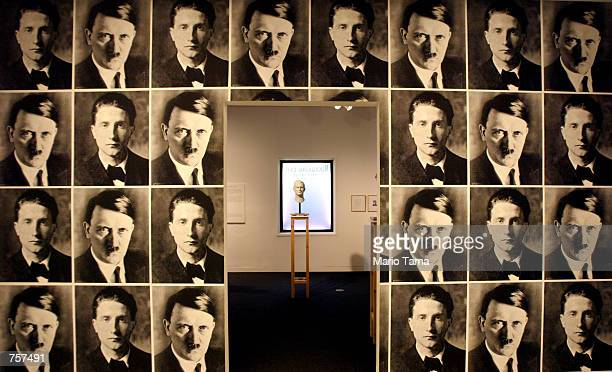 Bust of Nazi criminal Josef Mengele is surrounded by photographs of Adolf Hitler and artist Marcel Duchamp as part of the Mirroring Evil: Nazi...