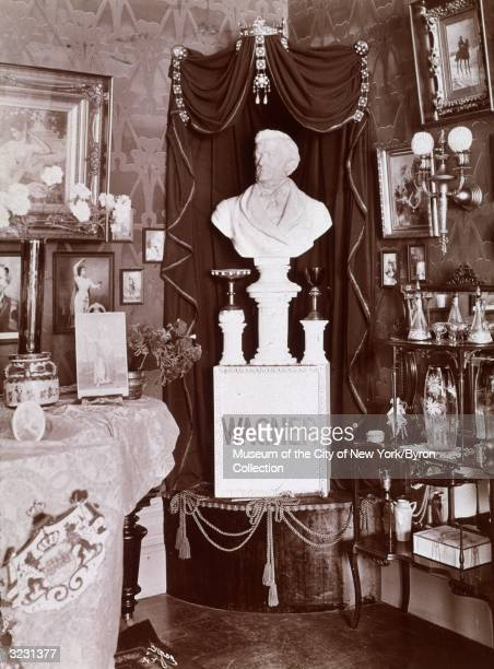 A bust of Richard Wagner sits on a pedestal beneath curtains and a crown at a shrine dedicated to the German composer in the corner of a room at a...