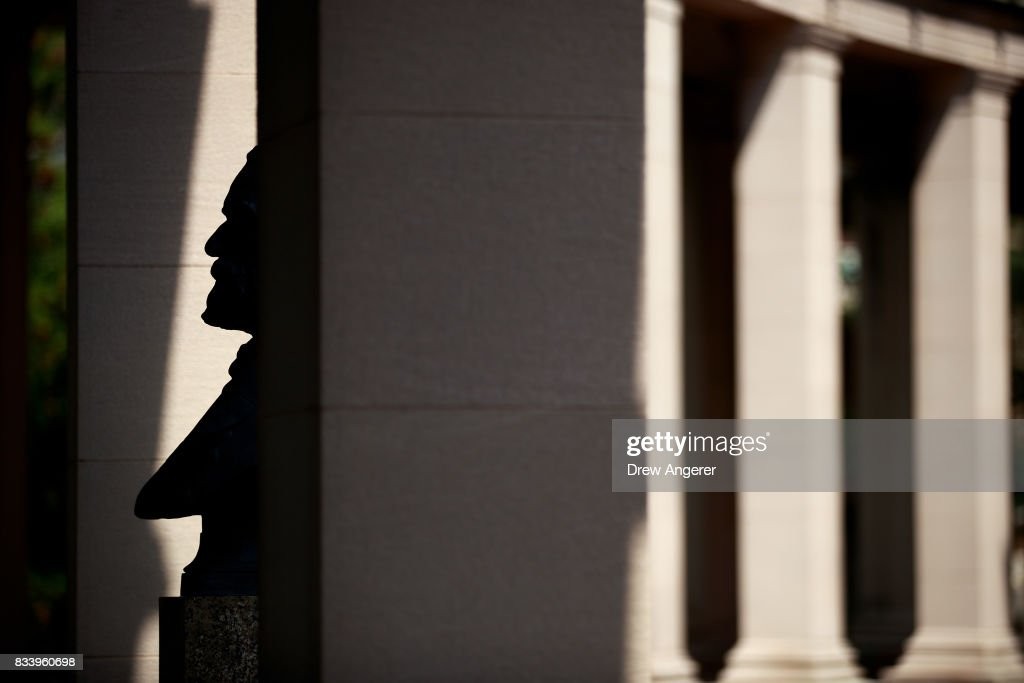 A bust of Robert E. Lee stands in the shadows in the 'Hall of Fame for Great Americans' on the campus of Bronx Community College, August 17, 2017 in the Bronx borough of New York City. On Wednesday night, the school announced the statues of Robert E. Lee and Confederate general Stonewall Jackson will be replaced and removed.