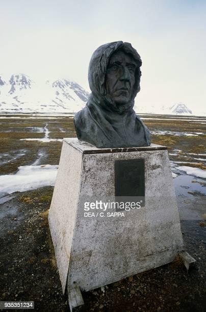 Bust of the Norwegian polar explorer Roald Amundsen NyAlesund Spitsbergen island Svalbard Norway
