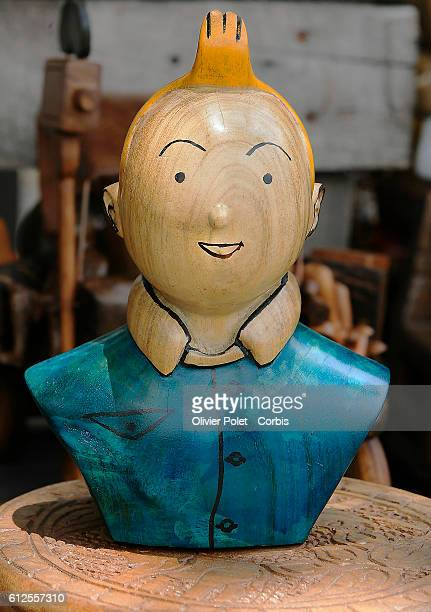 A bust of Tintin and statues of other characters from the comic strip Tintin for sale in front of Hotel Memling in Kinshasa's city center