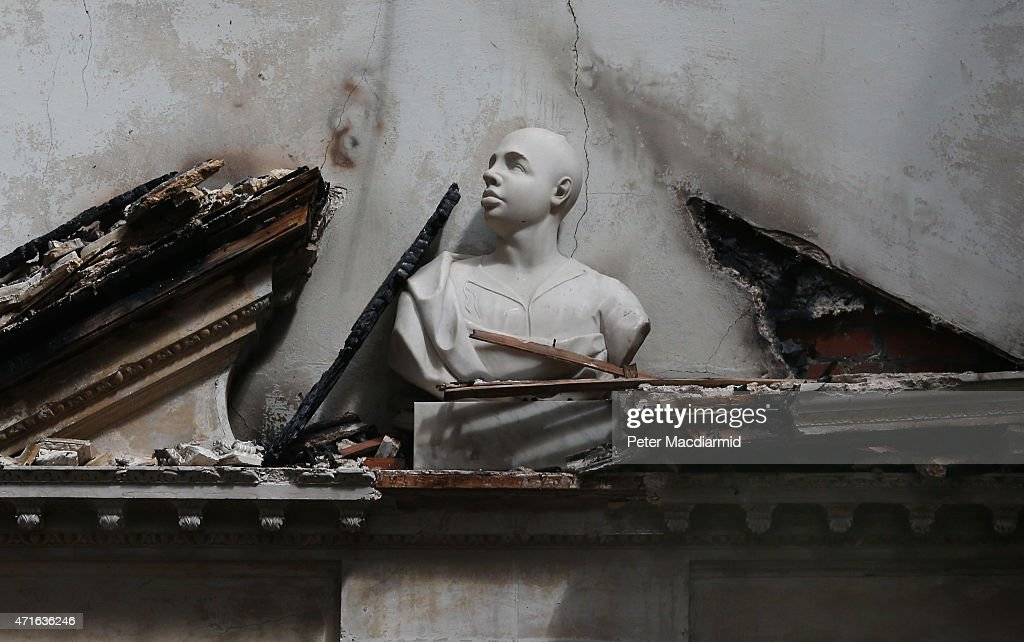 A bust sits on top a a fire damaged door entrance in The Marble Hall at Clandon Park House on April 30, 2015 near Guildford, England. Salvage operations have begun to rescue antiques from the remains of the 18th century stately home after a fire gutted large parts of the building.