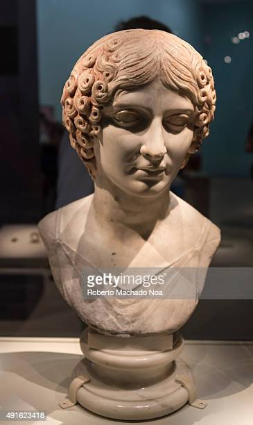 Bust statue of a woman with curly brown hair belonging to Pompeii archaeological collection on display at the Royal Ontario Museum The Royal Ontario...