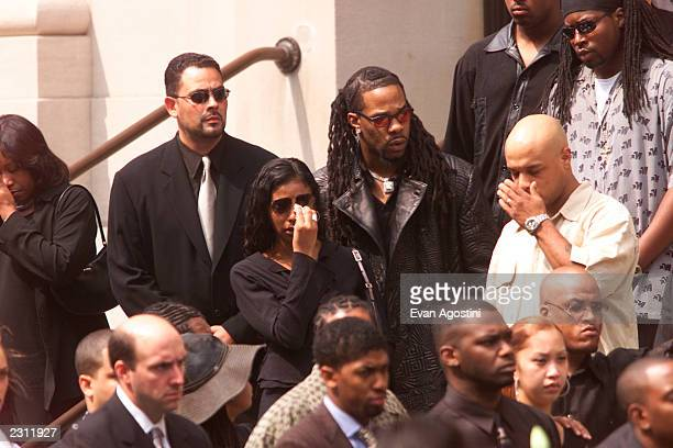 Busta Rhymes and Ananda Lewis as RB singer Aaliyah's funeral procession arrives at St Ignatius Loyola Roman Catholic Church in New York City...