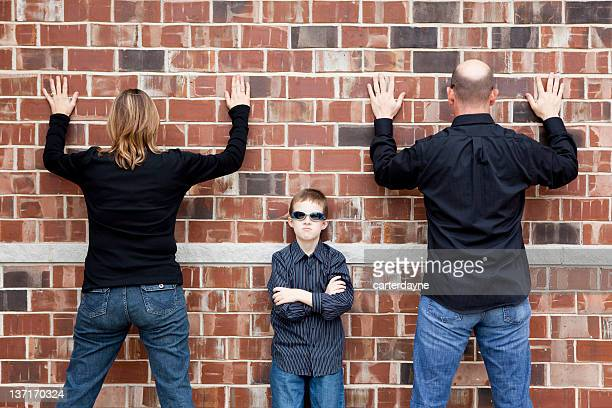 Busted; Father, Mother, Son Family, up against the wall