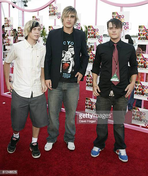 Busted James Bourne Charlie Simpson and Matt Jay arrive at the 2004 MTV Video Music Awards at the American Airlines Arena August 29 2004 in Miami...