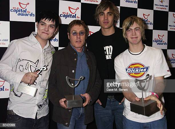 "Busted pose with Roger Daltrey in the awards room at the ""Capital FM Awards 2004"" at the Royal Lancaster Hotel on April 7, 2004 in London. The awards..."