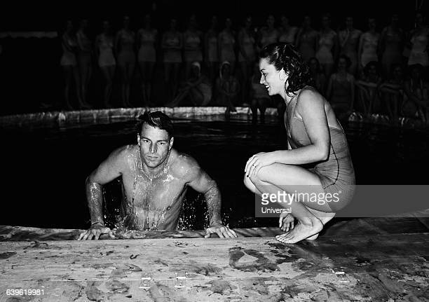 Buster Crabbe and Vicky Draves during an aquatic show