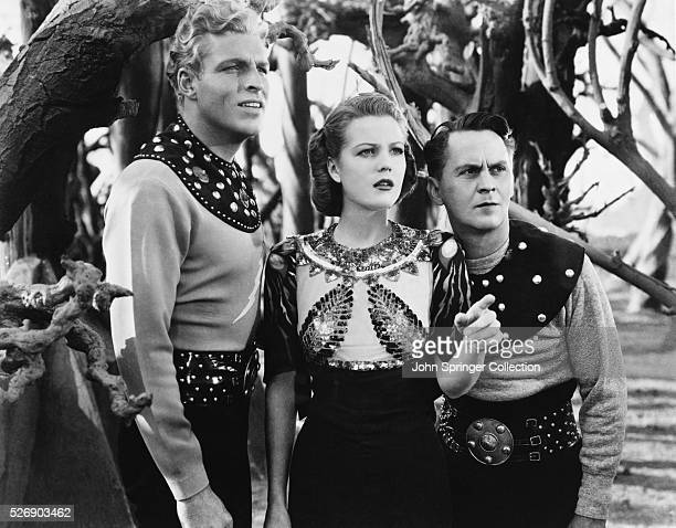 Buster Crabbe as Flash Gordon Jean Rogers as Dale Arden and Donald Kerr as Happy Hapgood