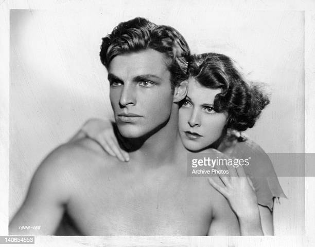 Buster Crabbe embraced by Frances Dee in a scene from the film 'King Of The Jungle' 1933