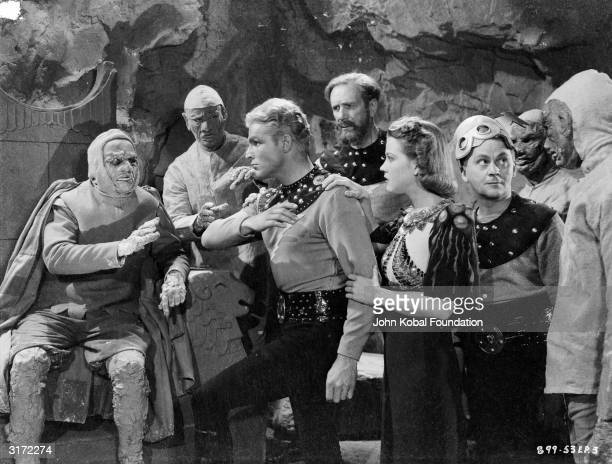 Buster Crabbe Jean Rogers Frank Shannon and Donald Kerr as Flash Dale Arden Doctor Zarkov and Happy Hapgood are captured by the Clay King in episode...