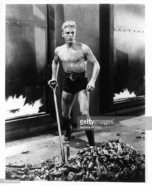 Buster Crabbe shoveling in a scene from the film 'Flash Gordon' 1936