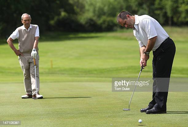 Buster Evans looks on as Matt Deal of Hendon Golf Club makes a putt on the 10th hole during the Virgin Atlantic PGA National ProAm Championship...