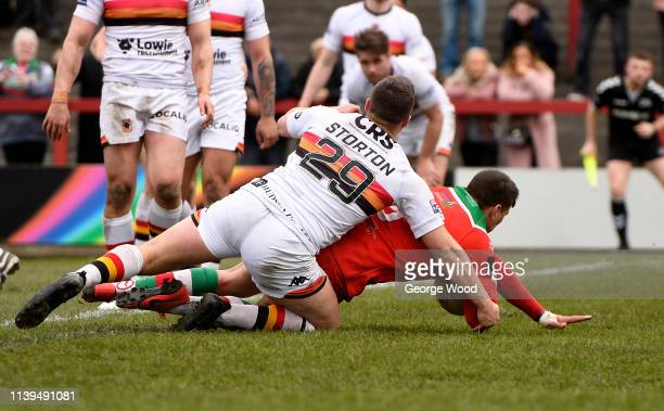 Buster Feather of Keighley Cougars goes over to score the opening try during the Challenge Cup match between Keighley Cougars and Bradford Bulls at...