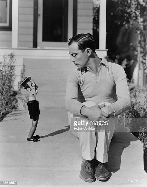 Buster Keaton silent comedy film star with a wooden doll of himself given to him as a gift by a German woodcarver