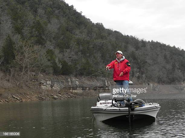 Buster Loving a longtime guide casts for white bass on the upper end of the reservoir on Bull Shoals Lake