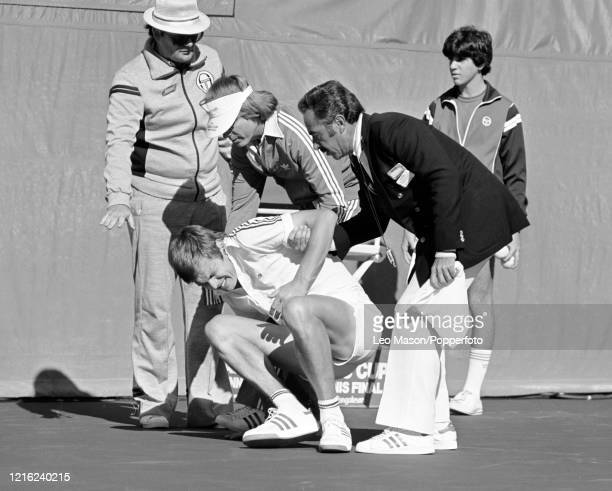 Buster Mottram of Great Britain receives help after a fall against John McEnroe of the United States in the 4th rubber of the 1978 Davis Cup Final at...