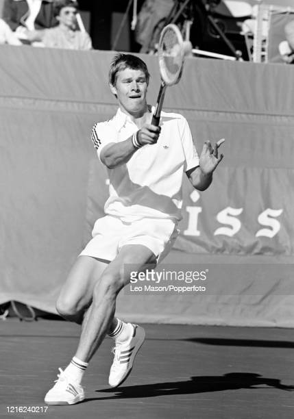 Buster Mottram of Great Britain returns the ball against John McEnroe of the United States in the 4th rubber of the 1978 Davis Cup Final at the...