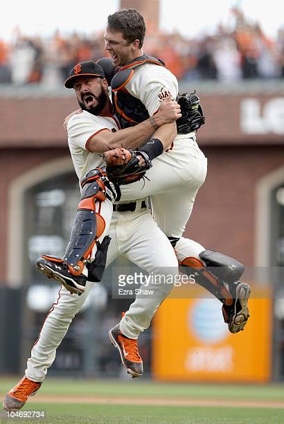 Buster Posey and Brian Wilson of the San Francisco Giants celebrate after they beat the San Diego Padres to win the National League West Title at ATT...