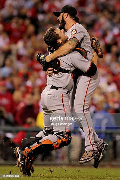 Buster Posey and Brian Wilson of the San Francisco Giants celebrate defeating the Philadelphia Phillies 32 and winning the pennant in Game Six of the...