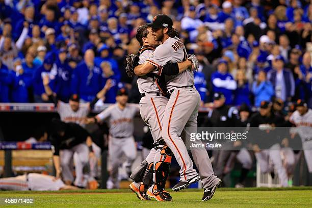Buster Posey and Madison Bumgarner of the San Francisco Giants celebrate after defeating the Kansas City Royals to win Game Seven of the 2014 World...
