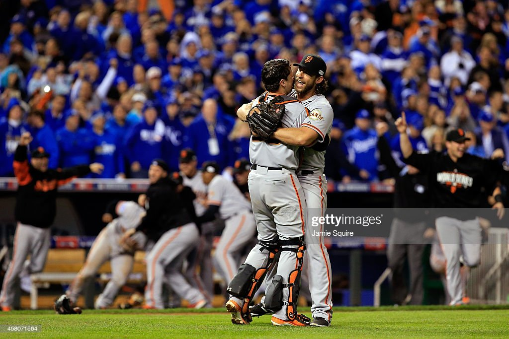 Buster Posey #28 and Madison Bumgarner #40 of the San Francisco Giants celebrate after defeating the Kansas City Royals to win Game Seven of the 2014 World Series by a score of 3-2 at Kauffman Stadium on October 29, 2014 in Kansas City, Missouri.