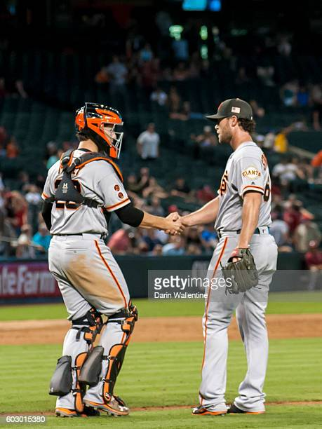 Buster Posey congratulates Hunter Strickland of the San Francisco Giants on the save after the MLB game against the Arizona Diamondbacks at Chase...