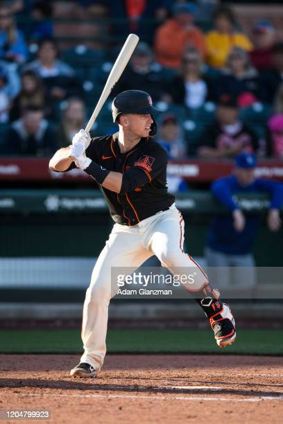 Buster Posey of the San Francisco Giants bats during the game against the San Francisco Giants on Saturday, February 22, 2020 at Scottsdale Stadium...