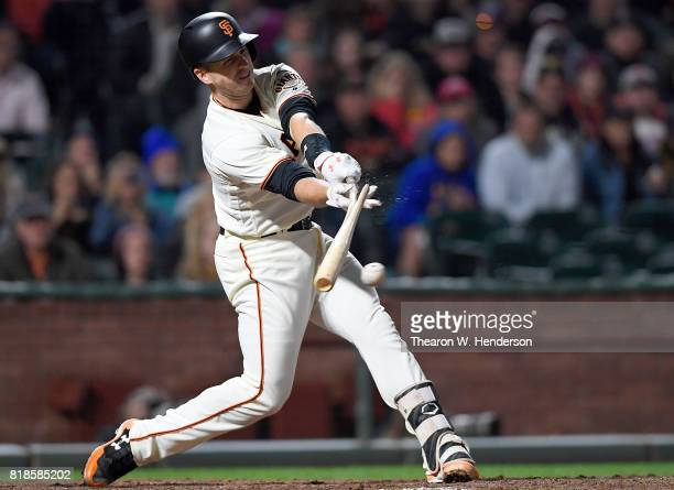 Buster Posey of the San Francisco Giants breaks his bat hitting an rbi single scoring Eduardo Nunez against the Cleveland Indians in the bottom of...
