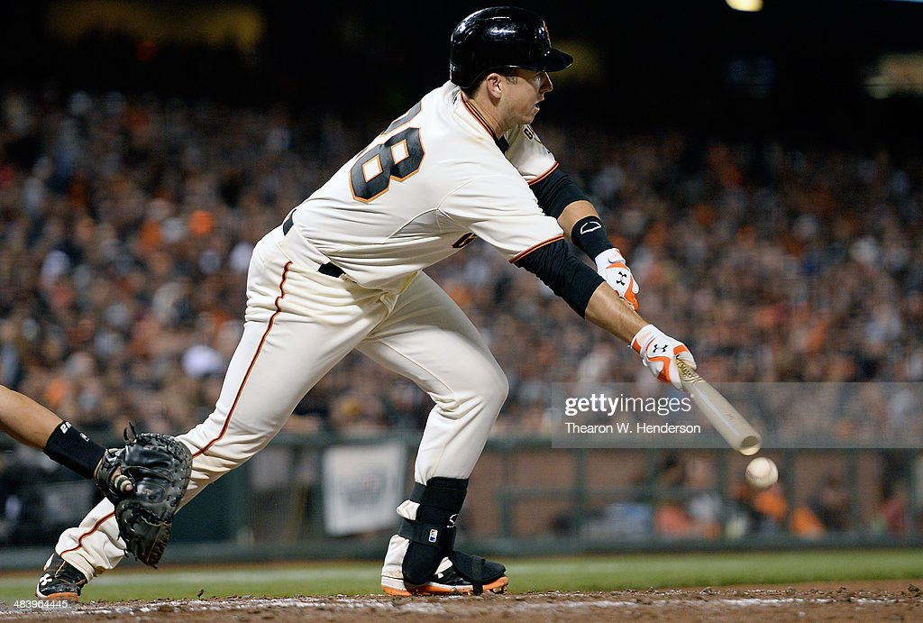 Buster Posey #28 of the San Francisco Giants bunts for an RBI single against the Arizona Diamondbacks in the bottom of the third inning at AT&T Park on April 10, 2014 in San Francisco, California. Angel Pagan scored on the bunt.