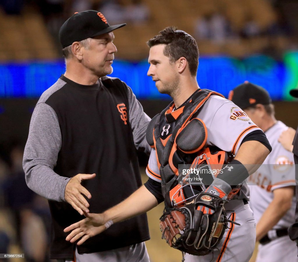 Buster Posey #28 of the San Francisco Giants celebrates a 4-3 win over the Los Angeles Dodgers with Manager Bruce Bochy #15 at Dodger Stadium on May 1, 2017 in Los Angeles, California.