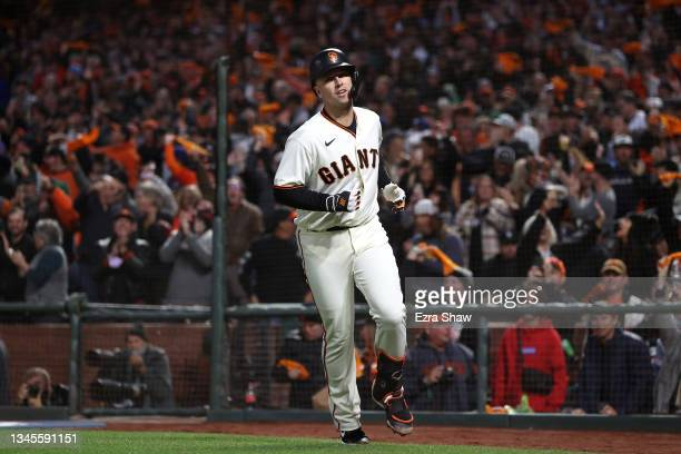 Buster Posey of the San Francisco Giants celebrates after hitting a two-run home run off Walker Buehler of the Los Angeles Dodgers during the first...