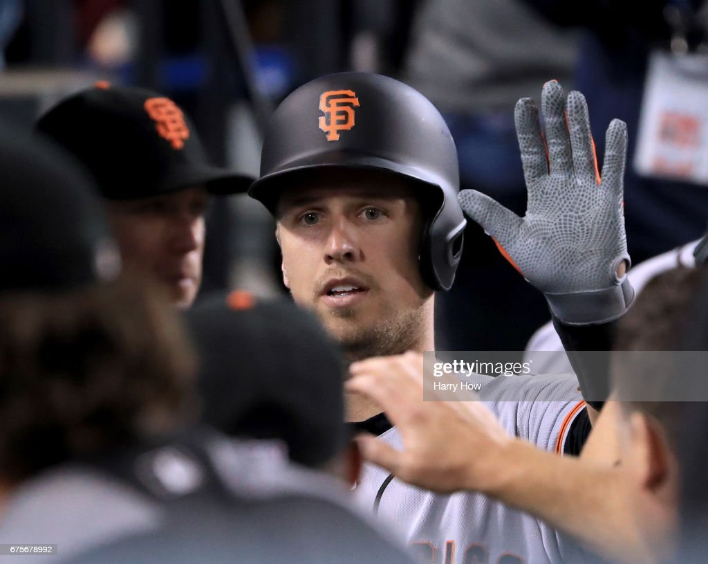 Buster Posey #28 of the San Francisco Giants celebrates his solo homerun in the dugout to take a 3-2 lead over the Los Angeles Dodgers during the third inning at Dodger Stadium on May 1, 2017 in Los Angeles, California.
