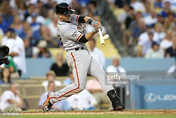 Buster Posey of the San Francisco Giants hits a grand slam home run in the third inning against the Los Angeles Dodgers at Dodger Stadium on June 19...