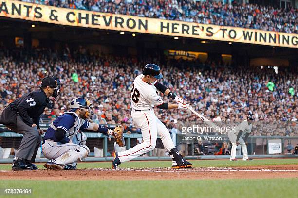 Buster Posey of the San Francisco Giants hits a grand slam home run against the San Diego Padres during the third inning at ATT Park on June 24 2015...