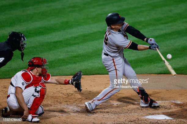 Buster Posey of the San Francisco Giants hits a home run during the sixth inning against the Philadelphia Phillies at Citizens Bank Park on April 20,...