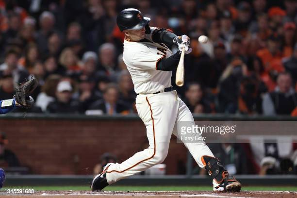 Buster Posey of the San Francisco Giants hits a two-run home run off Walker Buehler of the Los Angeles Dodgers during the first inning of Game 1 of...