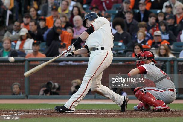 Buster Posey of the San Francisco Giants hits an RBI double against the Philadelphia Phillies in the third inning of Game Four of the NLCS during the...