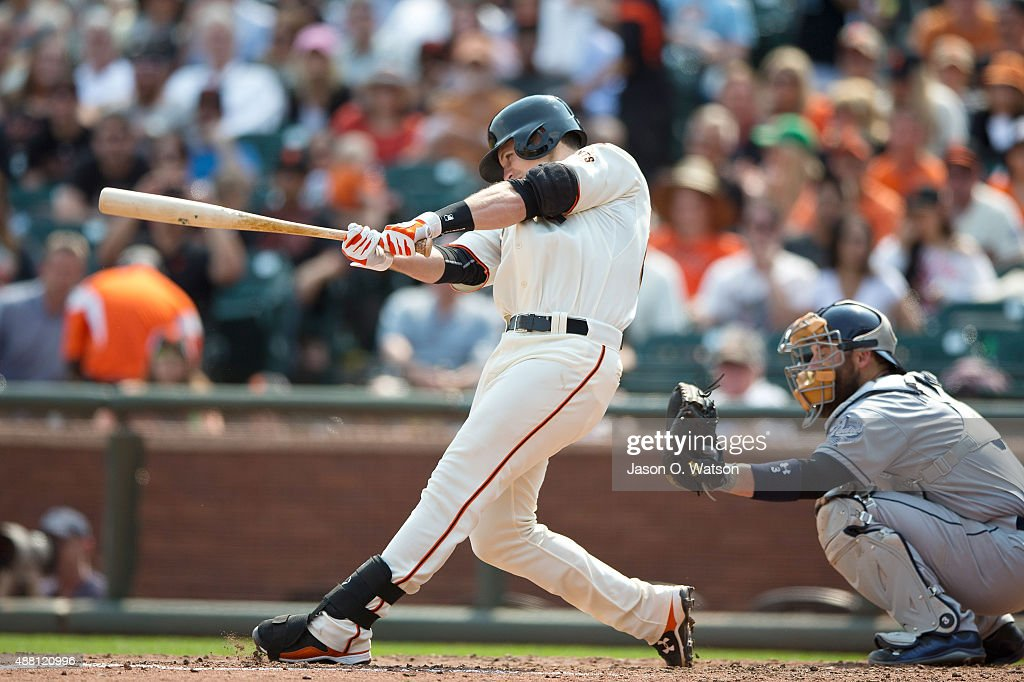 Buster Posey #28 of the San Francisco Giants hits an RBI double against the San Diego Padres during the fifth inning at AT&T Park on September 13, 2015 in San Francisco, California. The San Francisco Giants defeated the San Diego Padres 10-3.