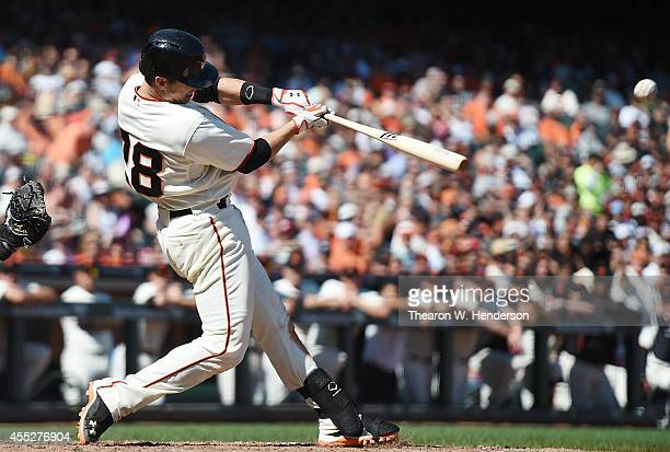 Buster Posey of the San Francisco Giants hits an rbi single scoring Juan Perez against the Arizona Diamondbacks in the bottom of the six inning at...