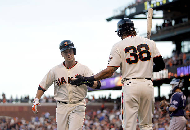 Buster Posey of the San Francisco Giants is congratulated...