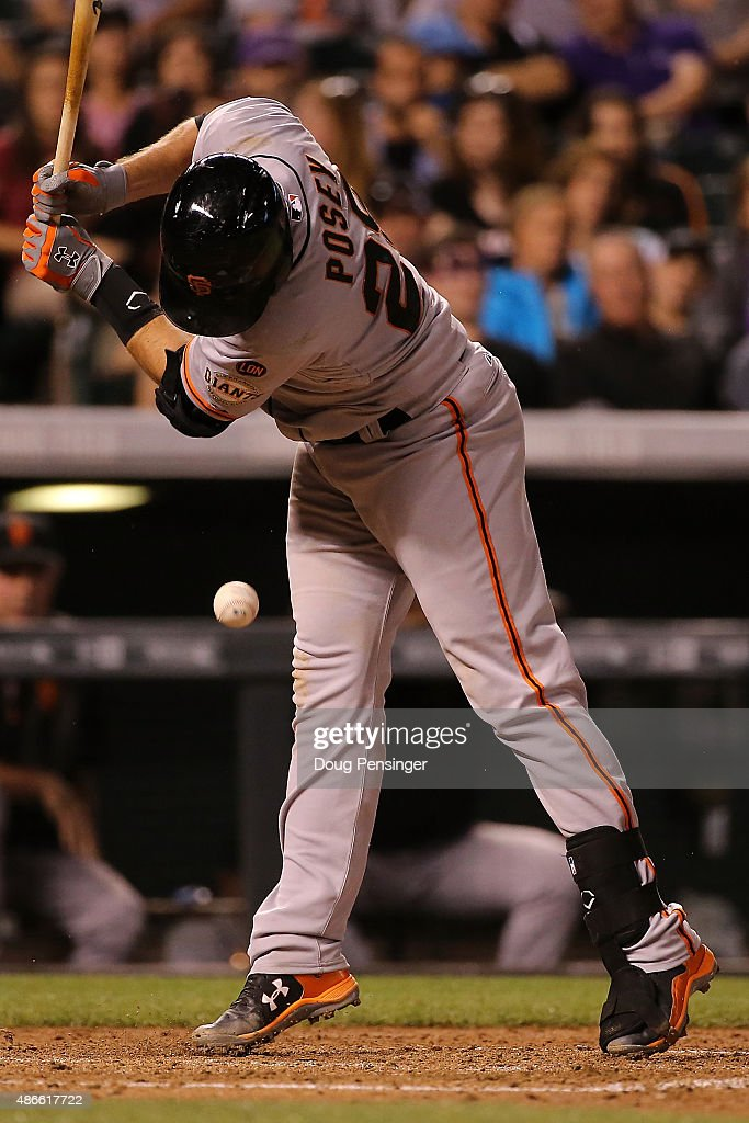 Buster Posey #28 of the San Francisco Giants is hit by a pitch by Jorge De La Rosa #29 of the Colorado Rockies in the sixth inning at Coors Field on September 4, 2015 in Denver, Colorado.