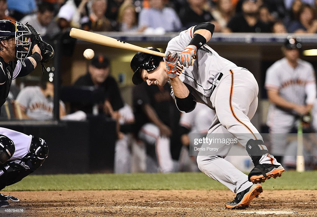 Buster Posey #28 of the San Francisco Giants is hit with a pitch during the ninth inning of a baseball game against the San Diego Padres at Petco Park September, 19, 2014 in San Diego, California.