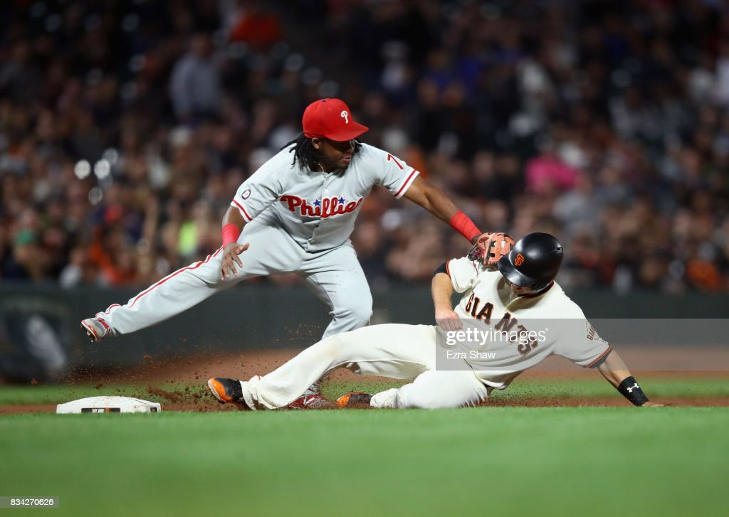 Buster Posey #28 of the San Francisco Giants is taggged out by Maikel Franco #7 of the Philadelphia Phillies at third base in the fifth inning at AT&T Park on August 17, 2017 in San Francisco, California.
